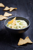 Guacamole with tortilla chips — Stock Photo