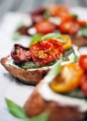 Bruschettas with half dried tomatoes — Stock Photo
