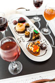 Tasting of wine and pattie chocolate pastries — Stock Photo