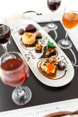Tasting of wine and pattie chocolate pastries — Stock Photo