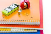 Stapler on pile on notebooks — Stock Photo