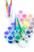 Paints and brushes School supplies — Stock Photo