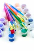 Paints and brushes School supplies — Stockfoto