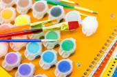 Paints, brushes and notebooks School supplies — Stok fotoğraf