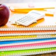 Notebooks, pencils, calculator, cash and apple School supplies — Stock Photo #52330575