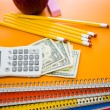 Notebooks, pencils, calculator, cash and apple School supplies — Stock Photo #52330599