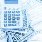 Calculator, cash and glasses - tax return — Stock Photo #52331003