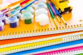 Paints, brushes and notebooks School supplies — Stock Photo
