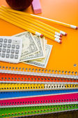 Notebooks, pencils, calculator, cash and apple School supplies — Stock Photo