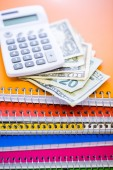 Cash, calculator and note books — Foto Stock