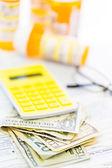Calculator, cash and glasses - tax return — Stock Photo