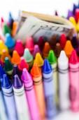 Crayons and dollar bills — Stock Photo