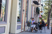 People sitting at cafe outdoors — Stock Photo