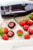 Strawberries and champaigne chocolate truffles. — Stock Photo