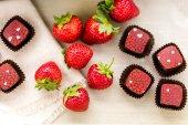 Strawberries and  chocolate truffles. — Stock Photo