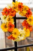 Autumn wreath with yellow and orange flowers — Stock Photo