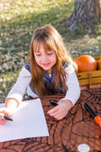 Girl and Pumpkin carving — Stock Photo