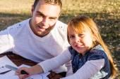 Father and daughter preparing for halloween — Stock Photo
