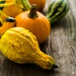 Organic Pumpkins on wooden table — Stock fotografie #56589397