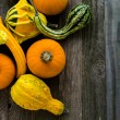 Organic Pumpkins on wooden table — Stockfoto #56589623