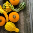 Organic Pumpkins on wooden table — Stock fotografie #56589657