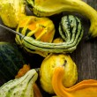 Organic Pumpkins on wooden table — Stock Photo #56589877