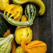 Organic Pumpkins on wooden table — Stock Photo #56589949
