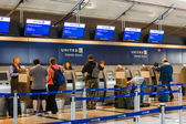 People at airport check in — Stock Photo
