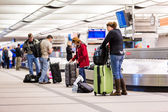 People at Baggage conveyor belt — Stock Photo