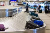 People at Baggage conveyor belt — Stok fotoğraf