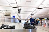 People at Baggage conveyor belt — Stock Photo