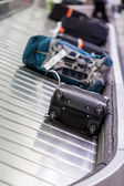 Picking up luggage after the flight — Stock Photo
