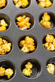 Flavored popcorn on the tray — Stock Photo