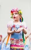 Little girl dancing in Russian costume — Stock Photo