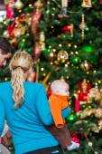 Mother with baby boy at Christmas tree. — Stock Photo