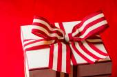 Box with red and white ribbon — Stockfoto