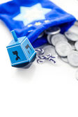 Blue dreidel with silver tokens — Stock Photo