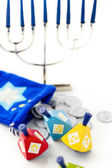 Colorful dreidels with silver tokens, Hanukkah — Stock Photo