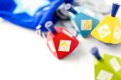 Colorful dreidels with silver tokens — Stock Photo