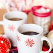 Hot chocolate with red snow flakes — Stok fotoğraf #59897233