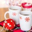 Hot chocolate with red snow flakes — Stock Photo #59897429
