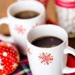 Hot chocolate with red snow flakes — Stock fotografie #59897459