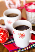 Hot chocolate with red snow flakes — Stockfoto