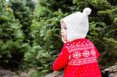 Cute baby girl in red Scandinavian dress — Stock Photo