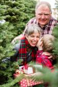 Family at Christmas tree farm — Stock Photo