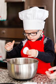 Little boy making cookies for Christmas — Stock Photo