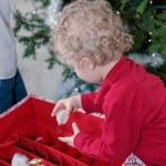 Little boy decorating Christmas tree — Stock Photo #60061517