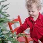 Little boy decorating Christmas tree — Stock Photo #60061755