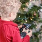 Little boy decorating Christmas tree — Stock Photo #60064135