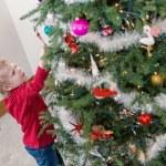 Little boy decorating Christmas tree — Stock Photo #60064825